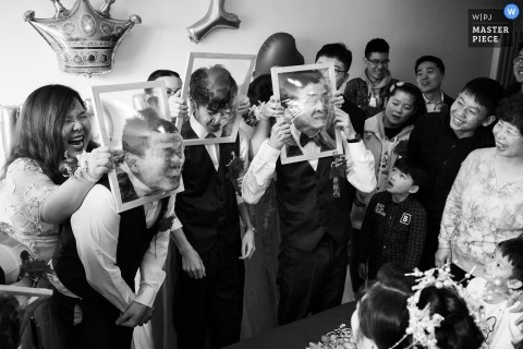 China Reception Game for the groomsmen - faces smashing through clear plastic wraped on frames