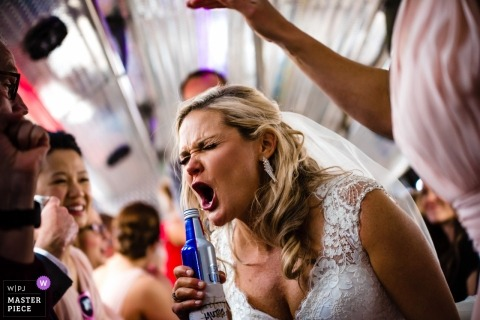 Wedding reception photo of an Elkhorn, NE Bride belting it out, singing her heart out