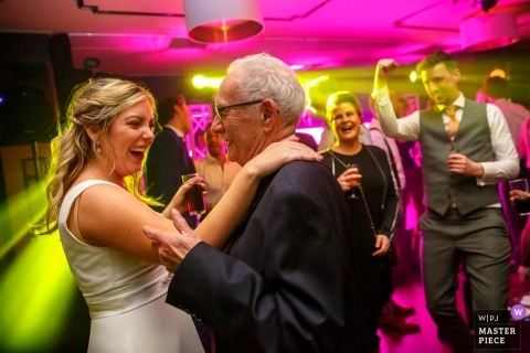 Wedding reception dance party in Enschede Netherlands - the Grandpa on the dancefloor with the bride