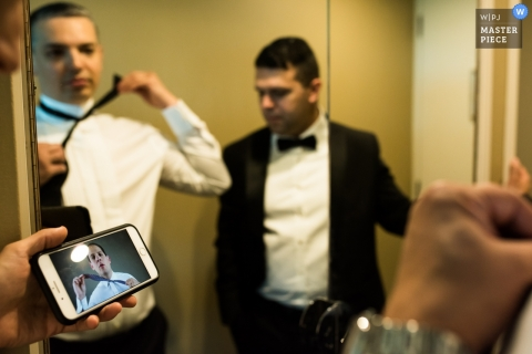 Melbourne Groom learns to tie a bow tie with the help of a video, Friends and a mirror