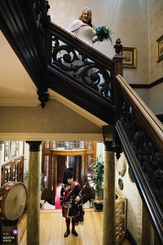 Bagpipes at Royal Scots Club, Edinburgh - the Bride comes down the stairs before the ceremony