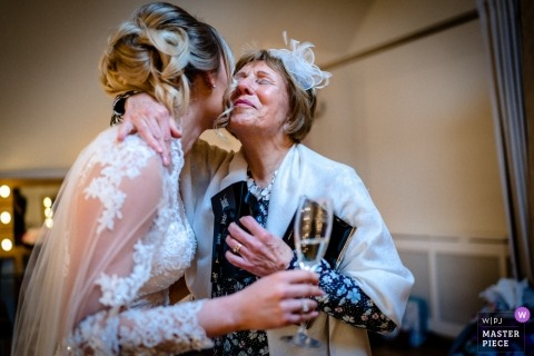 Millbridge Court, UK photography - the brides grandmother embraces her on her wedding day