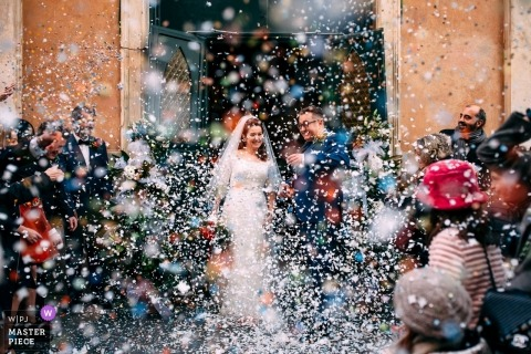 Fortezza del Priamar, Liguria, Italy - Rice toss at the bride and groom as they leave the church