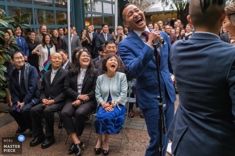 The groom and guests, including his mom, burst out laughing during the ceremony. - Los Angeles, California weddings