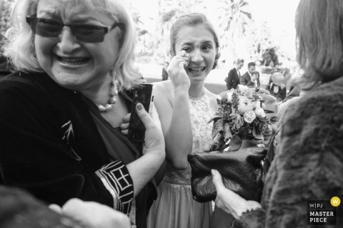 santa barbara, California wedding photographer - A flower girl sobs moments after the wedding ceremony