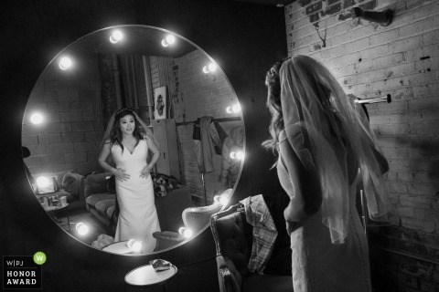 Los Angeles bride looks at herself in the getting ready room one last time before getting married