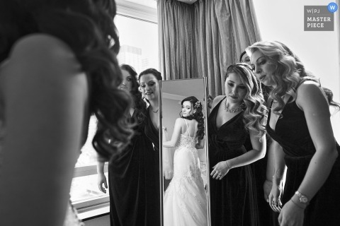 wedding photographer for Battery Gardens, New York - bride and bridesmaids with full length mirror