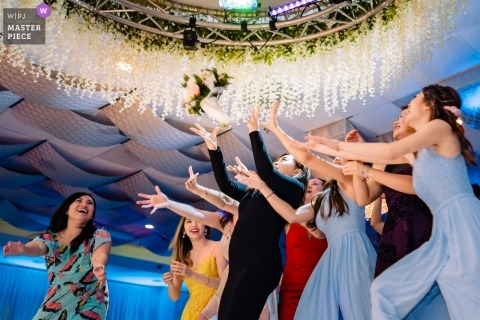 Garden Grove, CA wedding photography for receptions - Who's the next to catch the bouquet?!