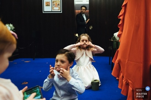 wedding photographer for Kensington Town Hall  - cheeky kids pre ceremony