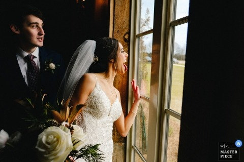 Jackson, MS wedding photographer - bride makes expression to guests outside wedding venue