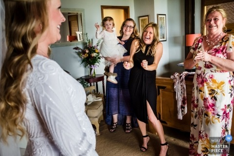Wedding photographer in Lake Tahoe, California | (private home) - Family and friends see bride in dress for the first time