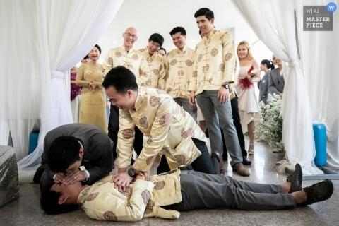 Roi Et, Thailand wedding photographer | Restore respiration demonstration on the wedding day CPR