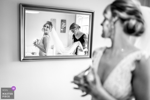 Carlingford, Ireland wedding photography - Bride seeing herself in the mirror for first time as she is about to leave for ceremony