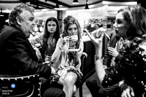 Wedding photography in Carlingford, Ireland | Guests enjoying a chat over a cup of tea at the wedding Reception