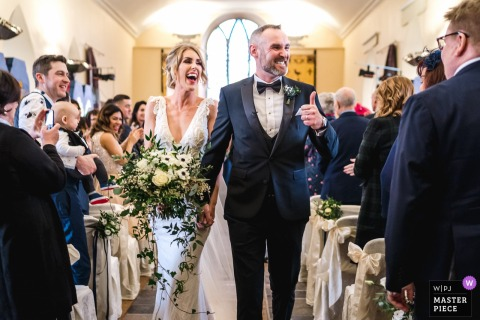 Carlingford, Ireland wedding photographer | Bride and Groom leaving church after the wedding ceremony