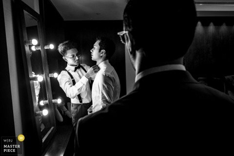 The Palace Hotel Dubai wedding photography | Groom getting ready - Black and white photograph with groomsmen