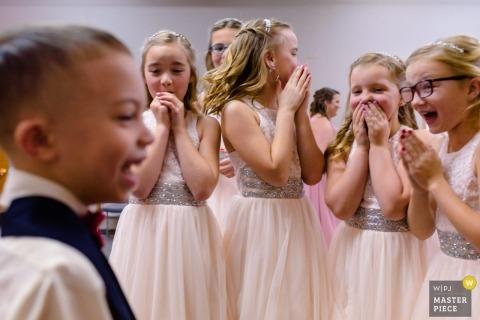 Omaha, NE wedding photographer | Flower Girls reactions to Ring Bearer