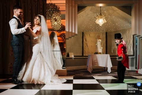 Thornton Hall wedding photographer | The greatest showman / pageboy with the bride and groom dancing