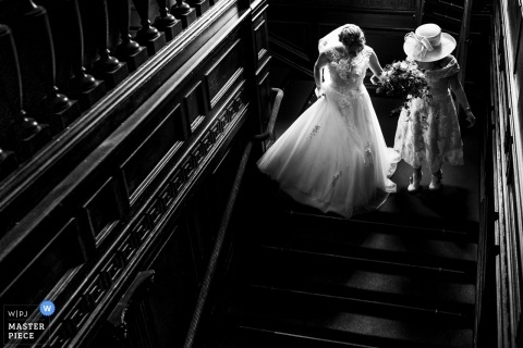 Eaves hall wedding reportage photographer | Stair way to marriage for the bride
