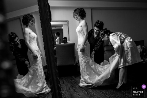 Wedding photography at the Acapulco Resort Convention SPA Hotel - photograph of the bride getting ready with help