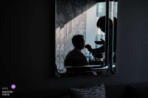 Bangkok wedding photographer | Getting ready with the groom silhouetted