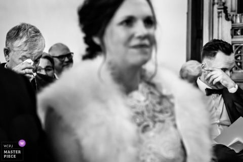 Dessel wedding Ceremony photograph of two men wiping tears on either side of the bride