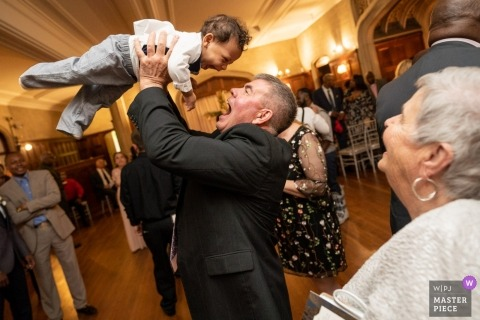 Atlanta Georgia wedding photography - small boy is lifted up on the dance floor