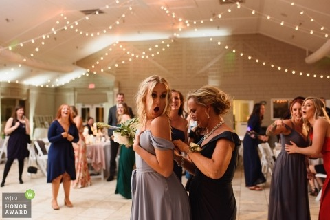 Sanderling Resort, Duck, NC, USA Wedding Event Photo - Bridesmaid reacts after her dress tears while catching the bouquet