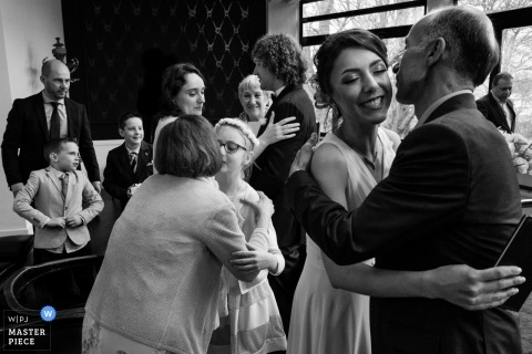 Zaventem Crown Plaza wedding photographer | Image of a big Family Hug