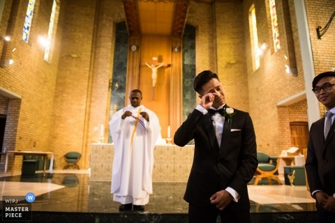 Victoria-AU Church wedding photography - the groom fights back tears - Bride coming