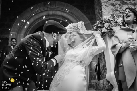 Alicante Wedding Photography - bride and groom showered with confetti as they leave the church ceremony