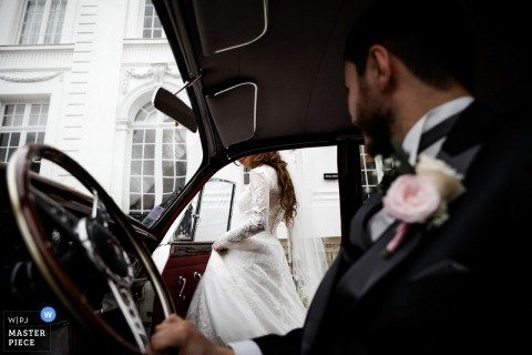 Lille - France bride entering the car - Let's go to the Church and get married - Paris wedding photographer