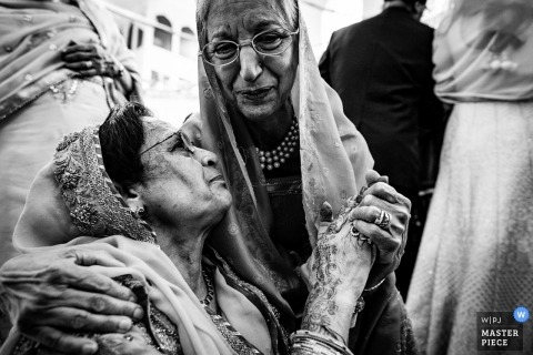 Birmingham, UK wedding photographers | Mother of the groom hugging in a black-and-white photograph