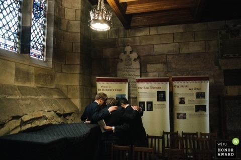 St Salvators Chapel, St Andrews Wedding Photo - Groom and groomsmen praying before the ceremony