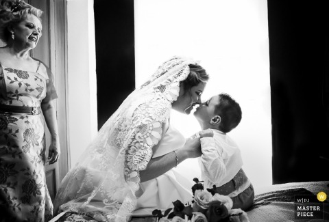 Wedding photography in Murcia Spain | Mother and son moment captured in a black-and-white photograph