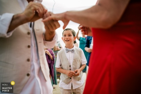 Koh Jum Resort Krabi wedding ceremony photography | the boy watches - put the ring on the bride
