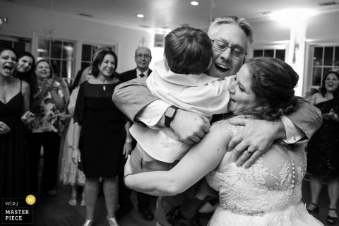 Kimball Hall, Roswell, GA wedding photographer | Bride and groom with their son near the end of the reception
