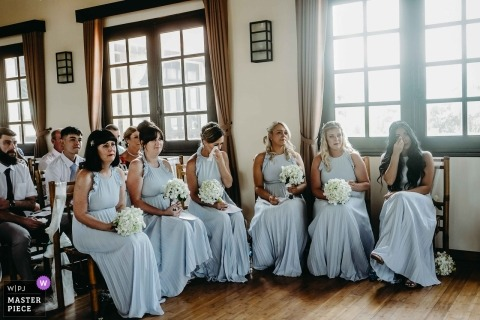 This photo was taken at Hoi An - bridal party holding their bouquets during the ceremony and wiping tears