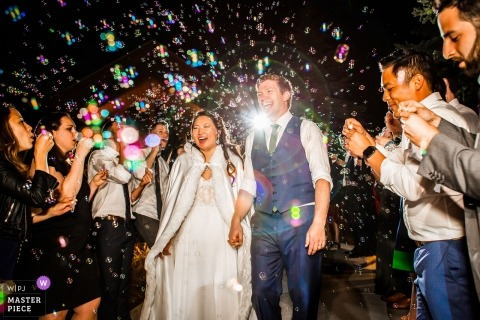 Edgewood Tahoe wedding photographer | Bride and Groom end the night with bubbles