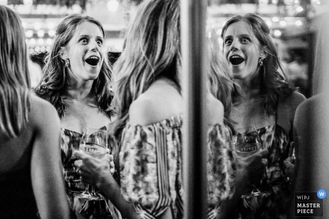 Cupitts Winery Ulladulla wedding photographer | Guests are caught in an expressive moment during a Wedding Reception Photo