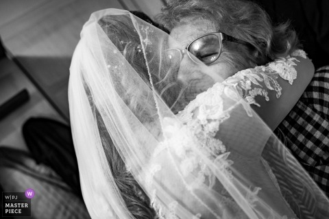 Sofia, Holiday-Inn wedding photography | The grandmother gives the bride a big hug