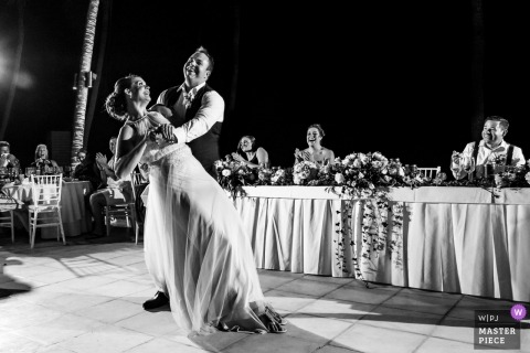 Marival Resort, Nuevo Vallarta, Mexico wedding photographer | the bride and grooms first dance at the outdoor reception party under lights