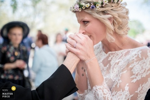 Mairie de Sauteyrargues wedding photography - The bride tenderly kisses the hand of her grandmother
