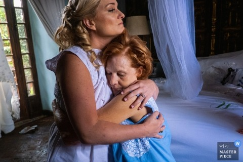 Wedding photography at casa hyder, san miguel de allende, mexico - mom hugs her daughter, the bride, while getting ready