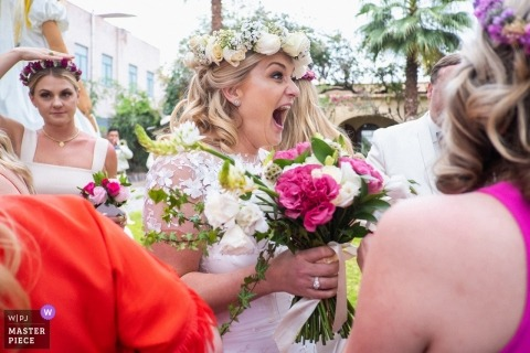 Wedding photographer for casa hyder, san miguel de allende, mexico | Bride reacts to friends moments after finishing her wedding ceremony