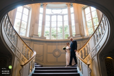 The Savile Club, London, UK | Bride walking down to ceremony with her father