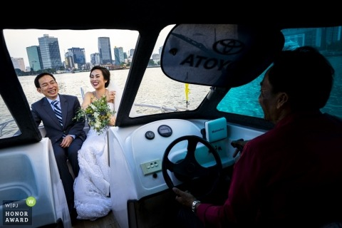 Bride and Groom aboard a boat near Ho Chi Minh City, Vietnam.