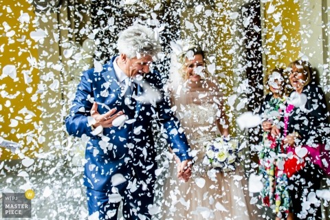 Villa Giulia Valmadrera Lecco Wedding Photo of Confetti Covering Bride and Groom