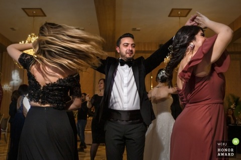 Acapulco Hotel | The groom dances with this sister at his wedding reception party.