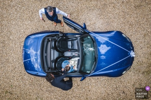 moulin des noues wedding day photography | moment capture with drone of bride in convertible car with groom